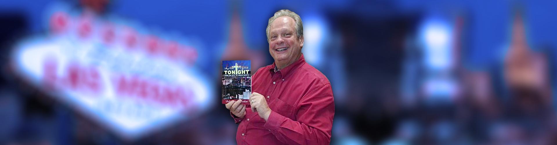 Dale Davidson holding book