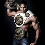 Alistair Overeem with three championship belts