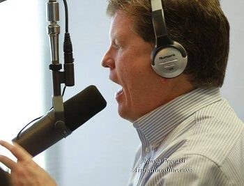 Kevin Price speaking into microphone