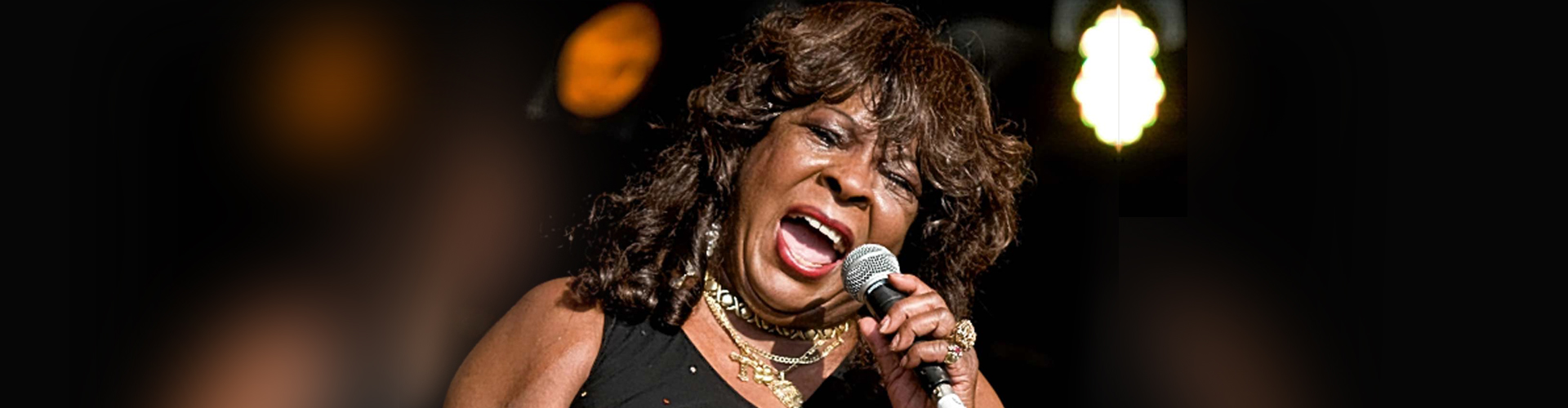 Martha Reeves speaking into microphone