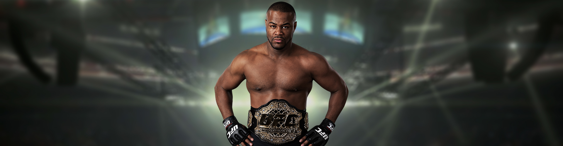 Rashad Evans with championship belt and hands on hips