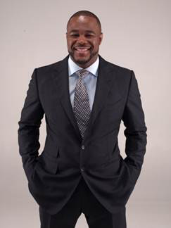 Rashad Evans with suit and hands in pockets