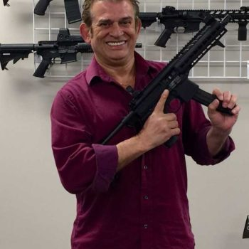 Simon Conway with automatic rifle
