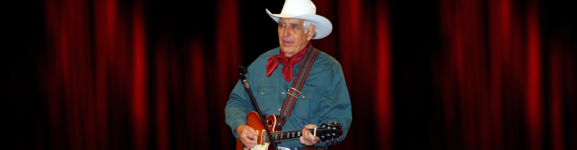 Tommy allsup with guitar on stage
